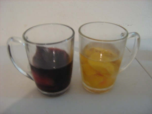 Wine with peaches in glasses